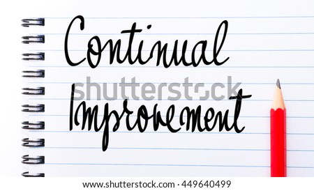Continual Improvement written on notebook page with red pencil on the right