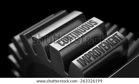 Continuous Improvement on the Metal Gears on Black Background.  - stock photo