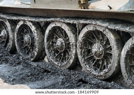 Continuous tracks covered by mud - stock photo