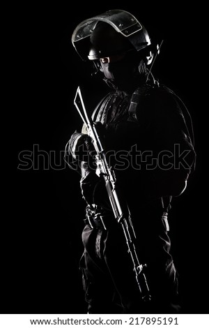 Contour shot of spec ops soldier on black background - stock photo