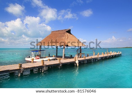 Contoy island nature reserve in Mexico wood pier with palapa