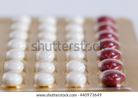 Contraceptive pill on white background