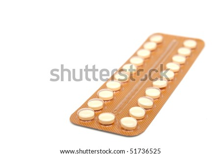 Contraceptive Pill on white background with selective focus - stock photo