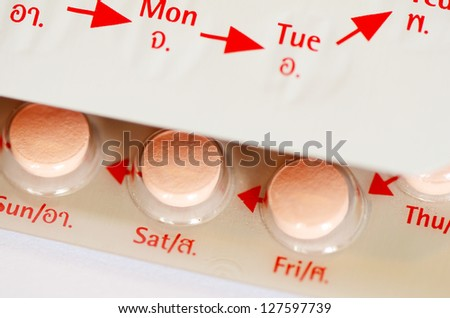 Contraceptive Pill with Thai and English Instructions. - stock photo