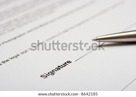 Contract about to being signed with a pen - stock photo