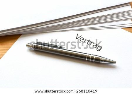 contract and pen lying on a desk in the office  - stock photo