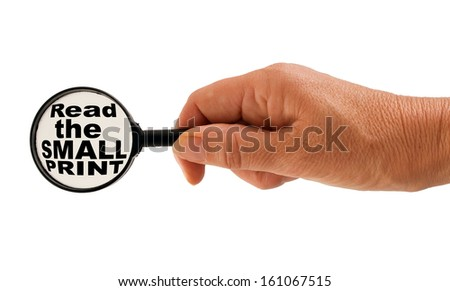Contract danger concept - hand with magnifying glass, white background - stock photo