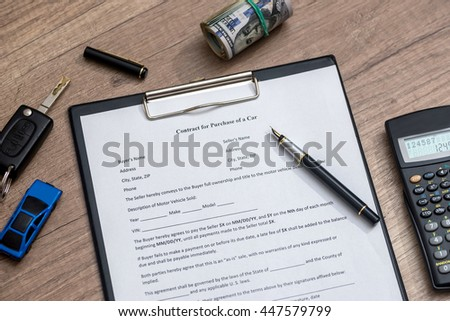 contract form with key, money and calculator - stock photo