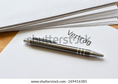 contract in german language and pen - stock photo
