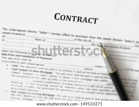 Contract management with pen  - stock photo