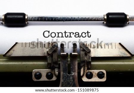 Contract on typewriter - stock photo