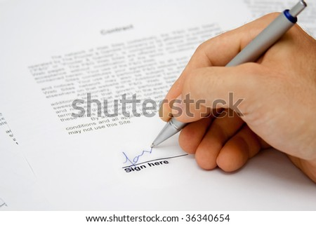 Contract signed by hand - stock photo