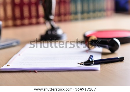 Contract waiting for a notary public sign on desk. Notary public accessories - stock photo