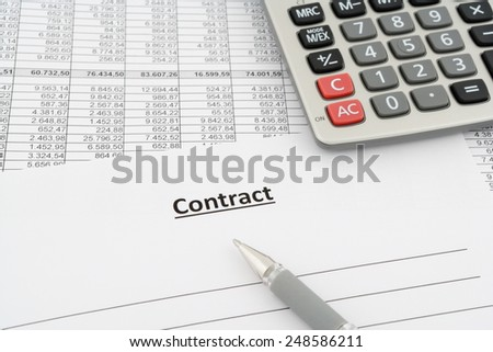 contract with numbers, calculator and pen