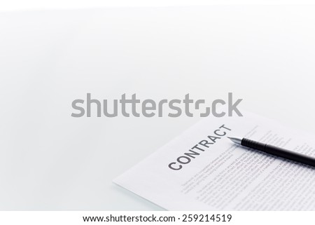 Contract with pen on it - stock photo