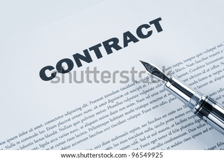 Contract with pen, toned blue - stock photo