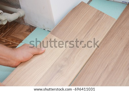 Contractor Install Wooden Laminate Flooring Insulation Stock Photo