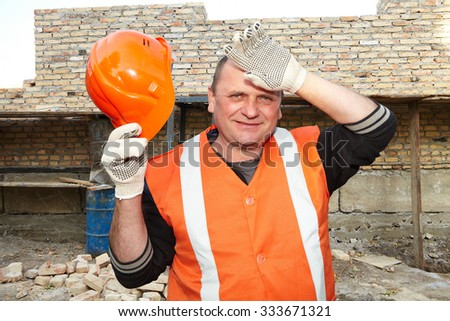 Contractor with helmet on background construction. Rest - stock photo