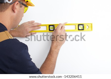 Contractor working with metre measure ruler. The builder - stock photo
