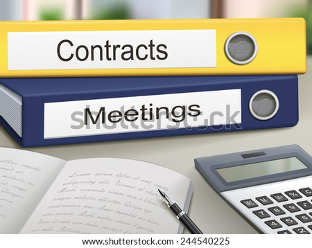 contracts and meetings binders isolated on the office table - stock photo