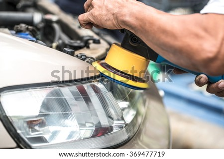 Contrary automobile headlamp - stock photo