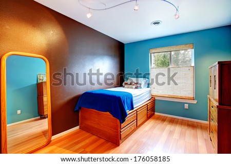 Contrast colors small bedroom - stock photo