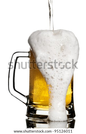 Contrast keg overflowing with light beer isolated on white - stock photo