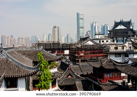 Contrast of old and new buildings in Shanghai, China.  - stock photo