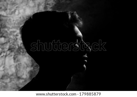 contrast silhouette profile of a young man in the style of yin and yang