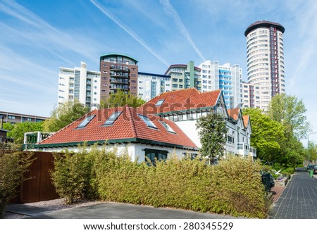 Contrasting and colorful high-rise and low-rise buildings in a Dutch town on a sunny day in spring. - stock photo