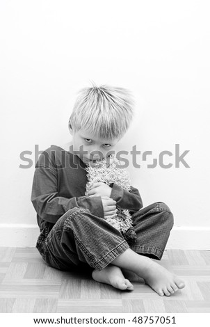 Contrasty Image of Child representing Autistic Behaviour. - stock photo