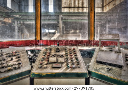 Control cabin in an abandoned factory, HDR processing - stock photo