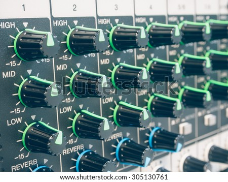 Control of sound levels  on a mixer. - stock photo