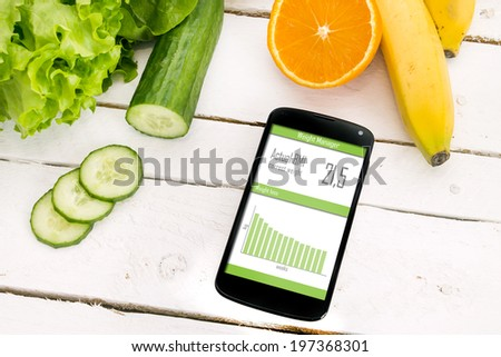 Control of your weight loss with mobile application. - stock photo
