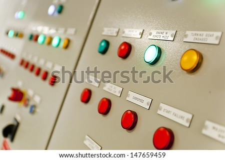 Control panel in main engine room of a extra large cargo ship - stock photo