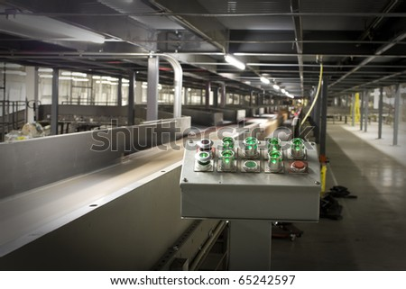Control panel of automated machine sorting packages for delivery - stock photo