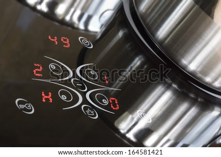 Control panel of induction ceramic cooker - stock photo