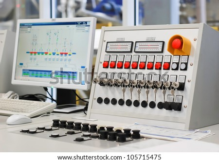 Control panel with computer monitor at wood factory - stock photo