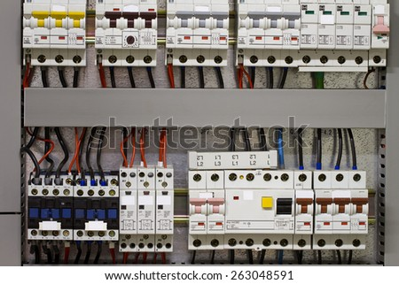 Control panel with static energy meters and circuit-breakers - fuse - stock photo