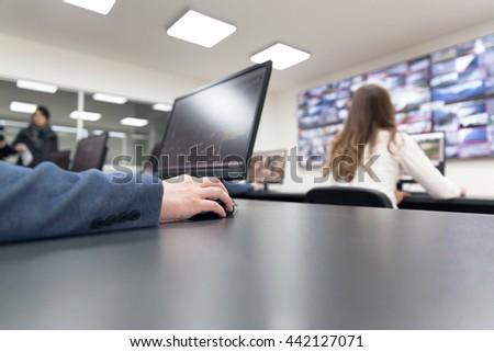 Control room operators. Security video surveillance. - stock photo