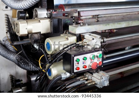control switch of a modern printing machine - stock photo
