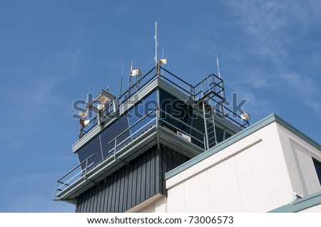 Control tower guides aircraft operations at busy airport - stock photo