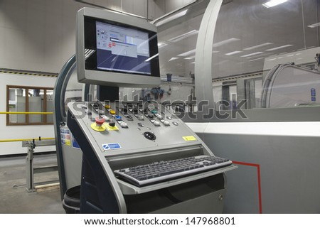 Control unit and computer screen of folding machine - stock photo