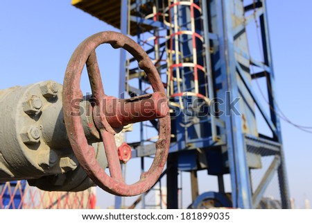 Control valve features beside the derrick   - stock photo