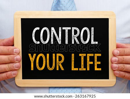 Control your Life - Businessman with blackboard - stock photo