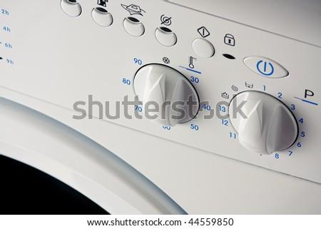 Controls knob of a washing machine - stock photo