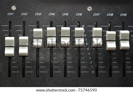 controls of an audio mixing device - stock photo