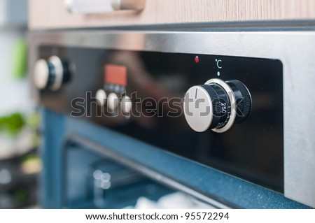 controls on the oven for a close-up - stock photo