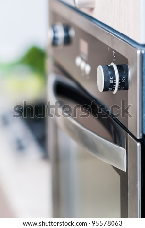 controls on the oven for a close-up. vertical view - stock photo