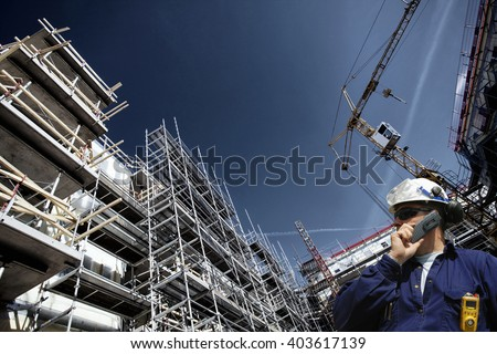 contruction worker, building site and cranes - stock photo